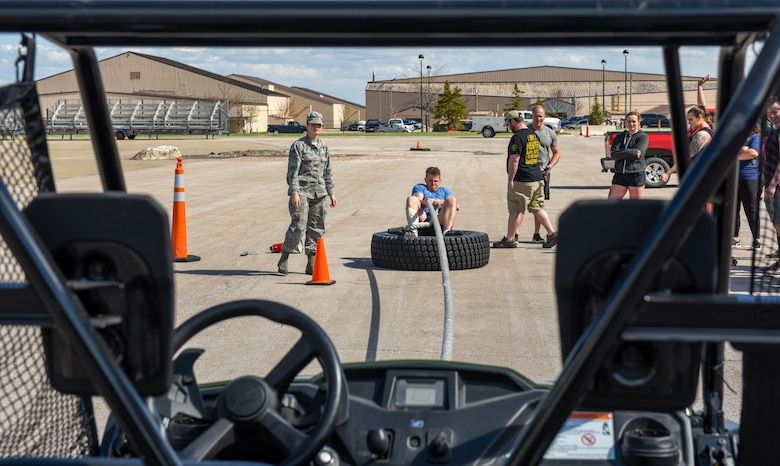 Capt. Max, assigned to the 89th Attack Squadron, is timed as he pulls an unmanned vehicle toward him for the Ellsworth Air Force Base's Strongest Competition on Ellsworth AFB, S.D., April 25, 2019. After all the competitors took their turns towing the vehicle across the line, they stepped up their game and also took turns pulling in a bus. During the free event, which was hosted by the 28th Force Support Squadron, participants performed feats of strength via five exercises: max-out deadlift, farmer's carry, keg run, tire flip and vehicle pull.  (U.S. Air Force photo by Tech. Sgt. Jette Carr)