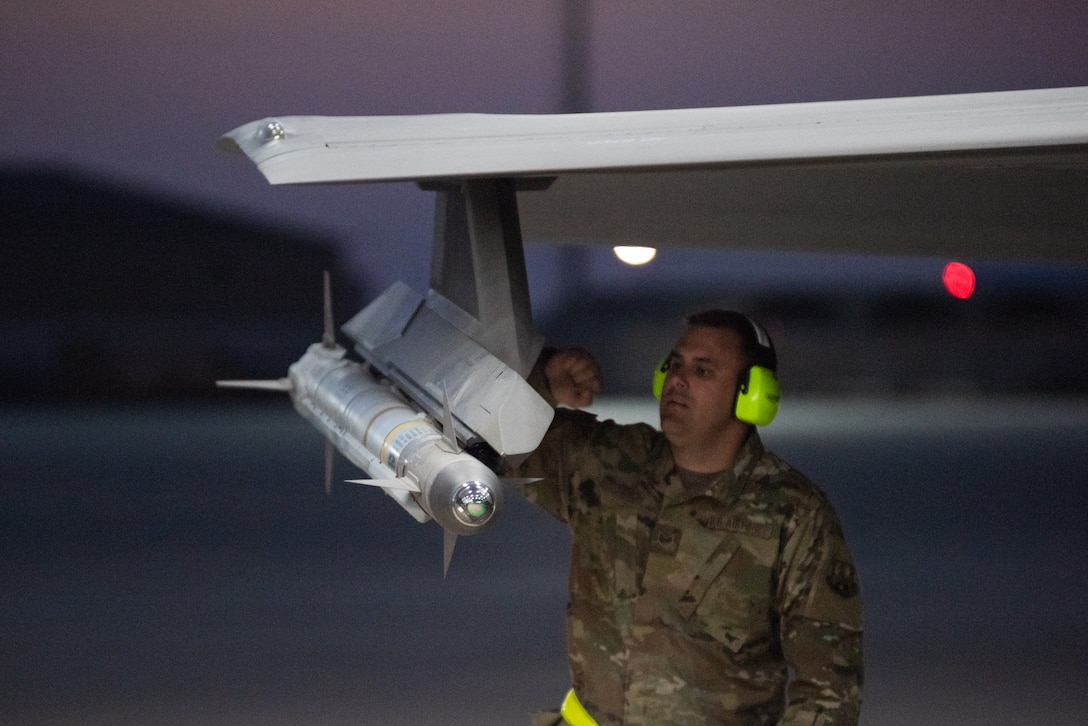 Staff Sgt. Karl Tesch, 380th Expeditionary Aircraft Maintenance Squadron weapons load crew chief, performs an inspection prior to launch check on an F-35A Lightning II April 26, 2019, at Al Dhafra Air Base, United Arab Emirates.