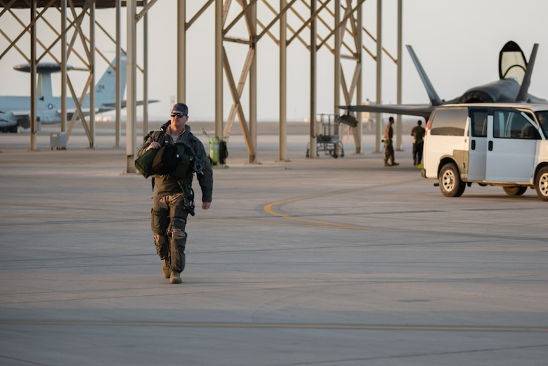 A 4th Expeditionary Fighter Squadron pilot steps to an F-35A Lightning II April 26, 2019, at Al Dhafra Air Base, United Arab Emirates.