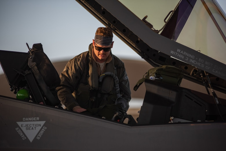 A pilot from 4th Expeditionary Fighter Squadron climbs into an F-35A Lightning II April 26, 2019, at Al Dhafra Air Base, United Arab Emirates.