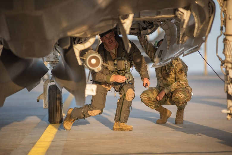 A pilot from 4th Expeditionary Fighter Squadron performs a preflight check on an F-35A Lightning II April 26, 2019, at Al Dhafra Air Base, United Arab Emirates.