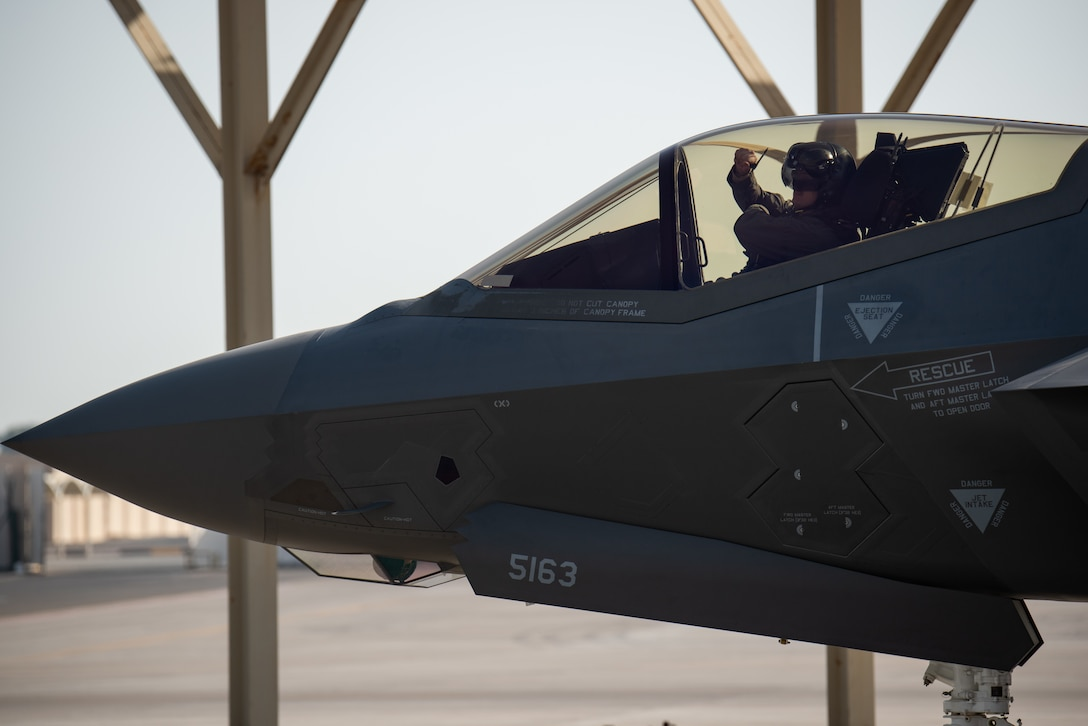 A pilot from 4th Expeditionary Fighter Squadron F-35A Lightning II pilot gestures to the crew chief into an April 26, 2019, at Al Dhafra Air Base, United Arab Emirates.