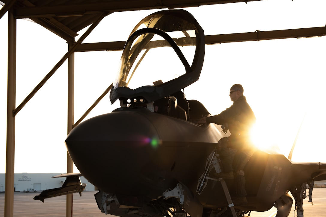 A 4th Expeditionary Fighter Squadron F-35A Lightning II pilot meets a crew chief April 26, 2019, at Al Dhafra Air Base, United Arab Emirates.
