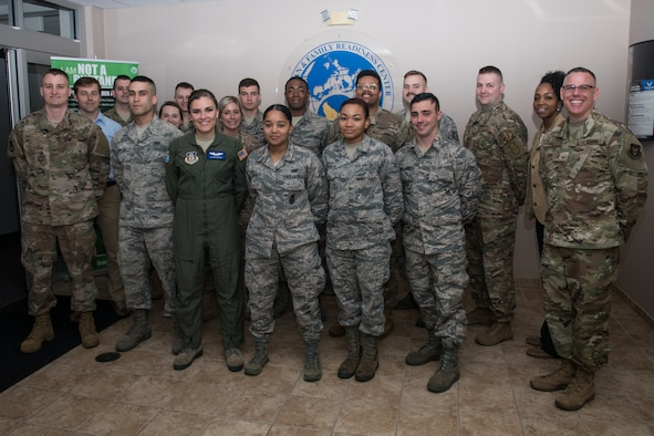 932nd Airlift Wing Master Sgt. Christopher Parr, public affairs photojournalist, far right, poses with the newest Citizen Airmen to join team Scott, May 4, 2019, Scott Air Force Base, Illinois. Each month leadership welcomes newcomers along with Wing agencies they provide briefings detailing the mission, Citizen Airmen responsibility, and answer questions each month.(U.S. Air Force photo by Senior Airman Brooke Deiters)