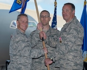 Col. Robert Thompson, 931st Maintenance Group commander, receives the 931st Aircraft Maintenance Squadron guidon