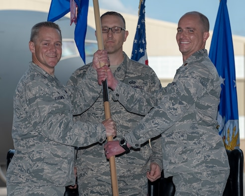 Maj. Michael Molloy, incoming 931st Aircraft Maintenance Squadron commander, receives the 931 AMXS guidon
