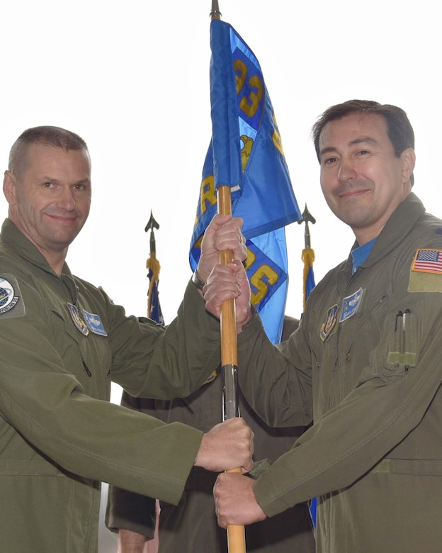 Col. Phil Heseltine, 931st Air Refueling Wing commander, hands the guidon to Lt. Col. Eric Rivero, the incoming 905th Air Refueling Squadron commander, during an official ceremony, May 4, 2019, McConnell Air Force Base, Kan.  Previously, the 905 ARS was the first Air Force flying unit to be assigned to Grand Forks Air Force Base, N.D, and it received its first KC-135 Stratotanker in 1960.  The unit stayed at Grand Forks until it was deactivated in 2010.