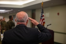 Elder Taylor, military relations with the Church of Jesus Christ of Latter-Day Saints, salutes as the National Anthem plays during the National Day of Prayer's breakfast, Sam Adams Sports Grill, May 2, 2019. President Harry Truman signed the law in 1952 stating that the National Day of Prayer invites people of all faiths to pray for the nation with President Ronald Reagan adding that the holiday will be observed on the first Thursday of May. (U.S. Marine Corps photo by Cpl. Zachary Orr)