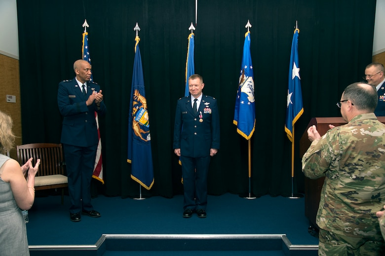 Brig. Gen. Rolf E. Mammen, commander of the 127th Wing and Selfridge Air National Guard Base, receives applause from Maj. Gen. Leonard Isabelle, commander of the Michigan Air National Guard and the audience during his promotion ceremony here, May 4, 2019.