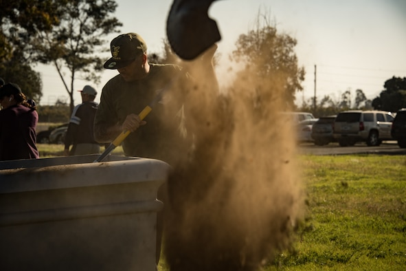U.S. Air National Guard Maj. Shane Patty removes dirt from a planter at the Channel Islands Air National Guard Station April 22, 2019. Patty and volunteer airmen used Earth Day as a platform to make beautification improvements to the base. (U.S. Air National Guard photo by Tech. Sgt. Nieko Carzis)