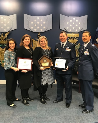 From left to right: Chrystal Crawford, Laurel Tidemason, Julie Morency, U.S. Air National Guard Lt. Col. Joe Wildman, and Col. Keith Ward accept an award for the 146th Airlift Wing's Airman and Family Readiness office headed by Julie Morency, who provided outstanding programs in support to 146 AW airmen and their families during the Department of Defense Reserve Family Readiness Awards presentation at the Pentagon Hall of Heroes, March 29, 2019.