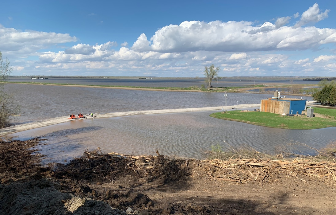 Crews pump water to keep an access road in Peru, Nebraska, from overtopping.