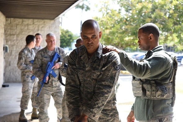 U.S. Air Force Airman 1st Class Damian Cole with the 147th Security Forces Squadron, gives instruction on two-man active shooter training at the 147th Group in San Diego, California, Apr. 6, 2019. Active shooter training is in place so that units are prepared for any threat they may encounter. (U.S. Air Force Photo and caption by Tech. Sgt. Joseph Courtney/ RELEASED)