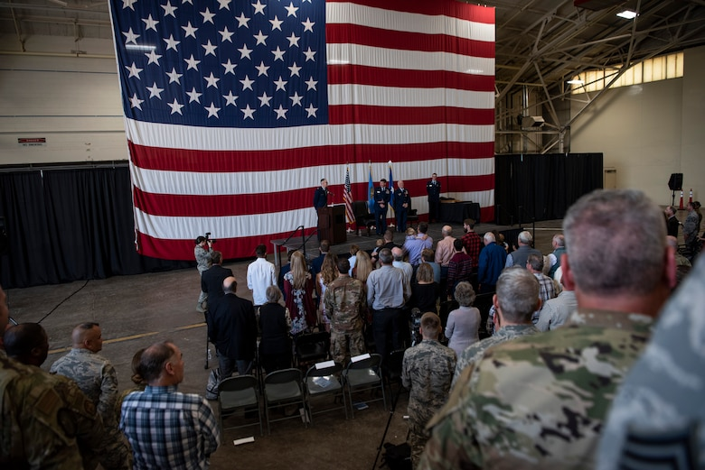 Col. Douglas Hayworth stands while the state song plays during his retirement ceremony at Will Rogers Air National Guard Base in Oklahoma City on May 4, 2019. Hayworth retired after serving more than 30 years with the Wing.(U.S. Air National Guard photo by Staff Sgt. Brigette Waltermire)