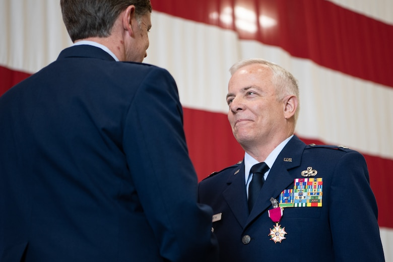 Col. Douglas D. Hayworth, 137th Special Operations Wing vice commander, receives the Legion of Merit from Brig. Gen. Thomas W. Ryan, Assistant Adjutant General - Air, Oklahoma National Guard, for Hayworth's service to the 137th SOW at Will Rogers Air National Guard Base in Oklahoma City, May 4, 2018. Hayworth retired after serving more than 30 years with the Wing. (U.S. Air National Guard Photo by Tech. Sgt. Kasey M. Phipps)
