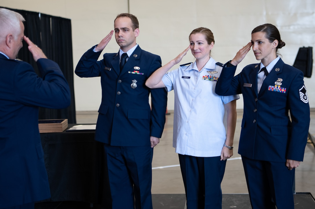Col. Douglas D. Hayworth, 137th Special Operations Wing vice commander, receives final salutes from his three children during his retirement ceremony held in the historical hangar at Will Rogers Air National Guard Base in Oklahoma City, May 4, 2018. Hayworth retired after serving more than 30 years with the Wing. (U.S. Air National Guard Photo by Tech. Sgt. Kasey M. Phipps)