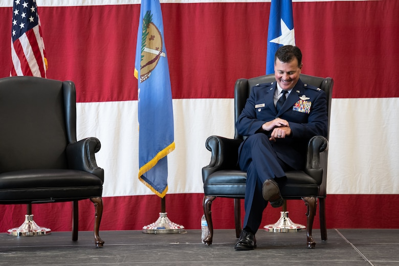 Col. Devin R. Wooden, former 137th Special Operations Wing commander, jokingly checks his watch during his retirement ceremony at Will Rogers Air National Guard Base, May 5, 2019. Wooden spent his entire career, nearly 33 years, promoting from Airman 1st Class to Colonel in the Oklahoma Air National Guard. (U.S. Air National Guard photo by Senior Airman Jordan Martin)