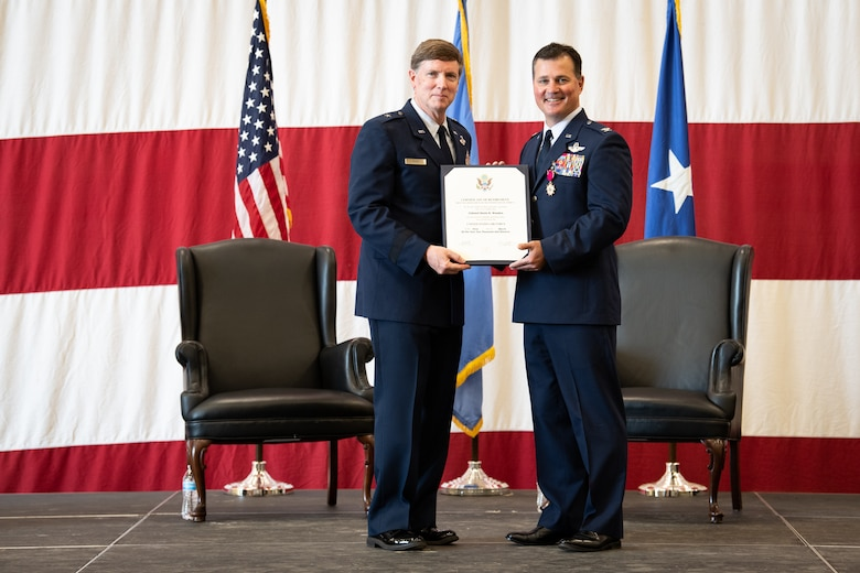 Col. Devin R. Wooden, former 137th Special Operations Wing commander, receives a certificate of retirement from the Oklahoma Assistant Adjutant General Brig. Gen. Thomas W. Ryan during his retirement ceremony at Will Rogers Air National Guard Base, May 5, 2019. Wooden spent his entire career, nearly 33 years, promoting from Airman 1st Class to Colonel in the Oklahoma Air National Guard. (U.S. Air National Guard photo by Senior Airman Jordan Martin)