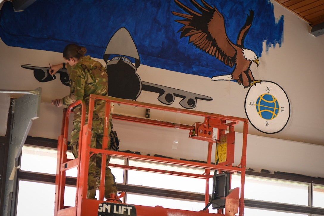 Airman First Class Amber Branch, 728th Air Mobility Squadron passenger services agent, paints a C-5 Galaxy on a mural in the squadron's heritage room Feb. 1, 2019, at Incirlik Air Base, Turkey. Branch dedicated all of her free time for a month to perfecting the mural's intricacies. (U.S. Air Force photo by Staff Sgt. Ceaira Tinsley)