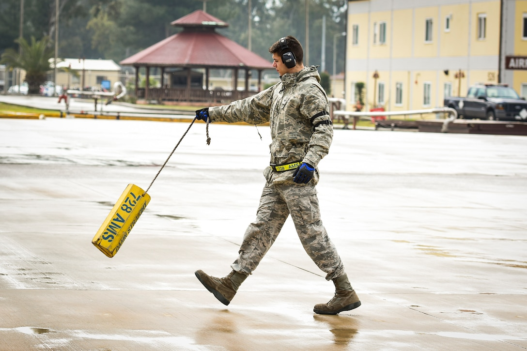Senior Airman Dane Johnson, 728th Air Mobility Squadron aircraft services journeyman, carries a chock to a K-loader March 3, 2019, at Incirlik Air Base, Turkey. The ramp services section is responsible for offloading all cargo from the aircraft. (U.S. Air Force photo by Staff Sgt. Ceaira Tinsley)
