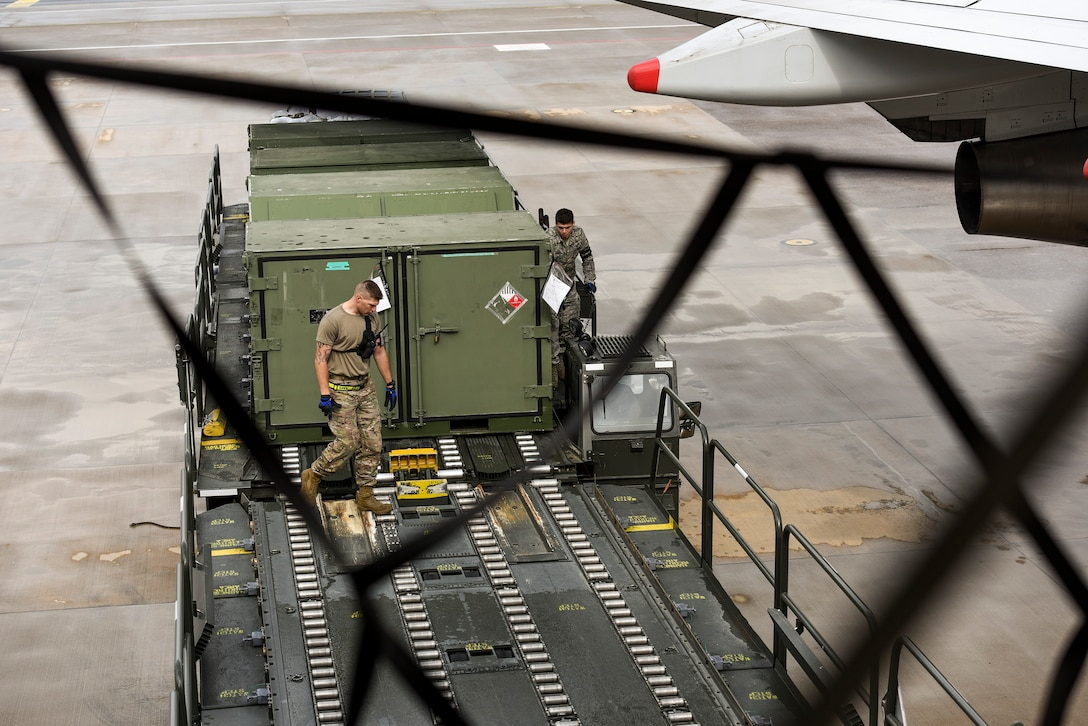 Staff Sgt. Daniel Lauritzen, 728th Air Mobility Squadron aircraft services supervisor, and Senior Airman Dane Johnson, 728th AMS aircraft services journeyman, unload cargo from a K-Loader March 3, 2019, at Incirlik Air Base, Turkey. Airmen in the 728th AMS use K-loaders to offload and download thousands of pounds of cargo weekly. (U.S. Air Force photo by Staff Sgt. Ceaira Tinsley)