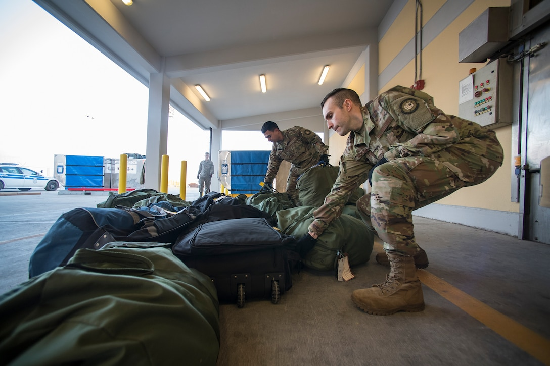 Airmen from the 728th Air Mobility Squadron load luggage March 19, 2019, at Incirlik Air Base, Turkey. The squadron serves as the 39th Air Base Wing's aerial port and supports transient Department of Defense and allied aircraft. (U.S. Air Force photo by Staff Sgt. Ceaira Tinsley)
