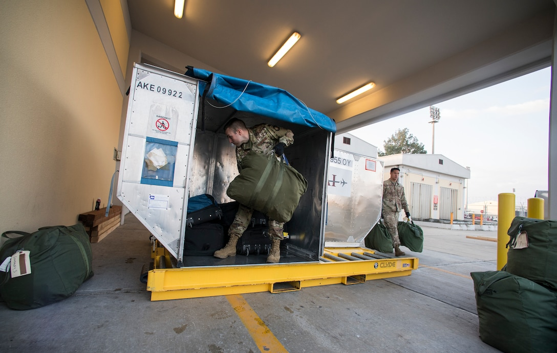 Airmen from the 728th Air Mobility Squadron load luggage March 19, 2019, at Incirlik Air Base, Turkey. As a team, these Airmen sort, load and unload more than 2,000 pounds of baggage weekly. (U.S. Air Force photo by Staff Sgt. Ceaira Tinsley)