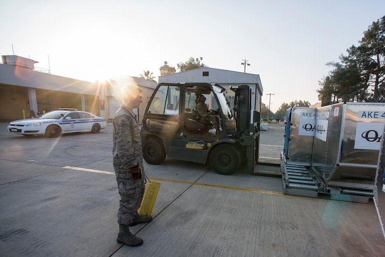 Airmen from the 728th Air Mobility Squadron transport luggage containers March 19, 2019, at Incirlik Air Base, Turkey. The 728th AMS Aircraft Services Flight consists of four sections: ramp services, special handling, clean and dirty fleet and cargo processing. (U.S. Air Force photo by Staff Sgt. Ceaira Tinsley)