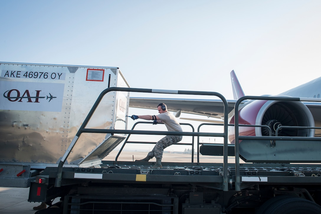 Airman Dylan Albright, 728th Air Mobility Squadron aircraft service journeyman pulls a luggage container March 19, 2019, at Incirlik Air Base, Turkey. The squadron falls under the 521st Air Mobility Operations Group, headquartered at Naval Station Rota, Spain, and the 521st Air Mobility Operations Wing, headquartered at Ramstein Air Base, Germany. (U.S. Air Force photo by Staff Sgt. Ceaira Tinsley)