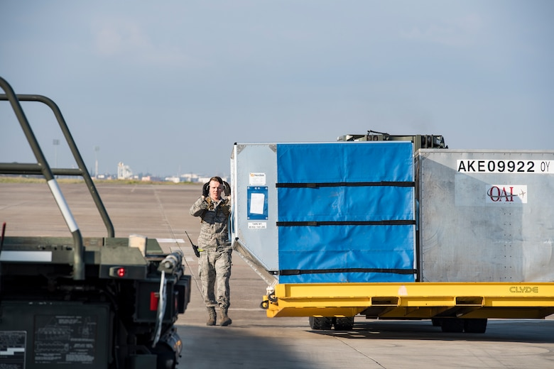 Senior Airman Waite Rowland, 728th Air Mobility Squadron aircraft service journeyman, marshals a forklift carrying luggage containers March 19, 2019, at Incirlik Air Base, Turkey. The 728th AMS consists of three flights: Aerial Port, Aircraft Maintenance and Combat Readiness and Resources. Together, they ensure safe and effective en route support for missions transiting Europe, Africa, and Southwest Asia and support five combatant commanders with aerial port operations, aircraft maintenance, and command and control 24/7/365. (U.S. Air Force photo by Staff Sgt. Ceaira Tinsley)