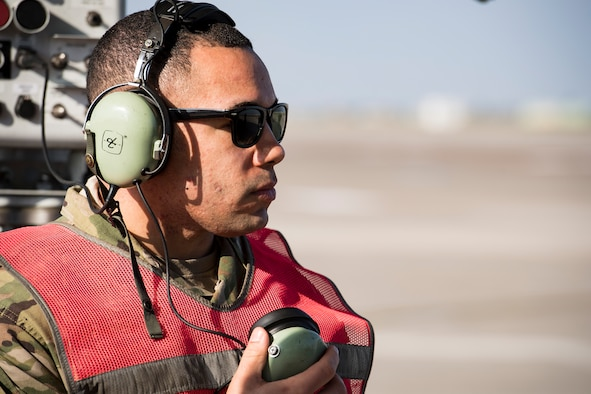 Staff Sgt. Jeff Jordan, 728th Air Mobility Squadron Maintenance Section crew chief, communicates with the pilot prior to aircraft takeoff March 19, 2019, at Incirlik Air Base, Turkey. When the maintenance section gives an all clear, Jordan communicates to the pilot they are cleared to start engines. The Aircraft Maintenance Flight projects Air Mobility Command's global air mobility mission by executing flight line operations to generate, launch, recover, service and repair C-17 Globemaster III, C-5 Galaxy, and other commercial cargo aircraft. (U.S. Air Force photo by Staff Sgt. Ceaira Tinsley)