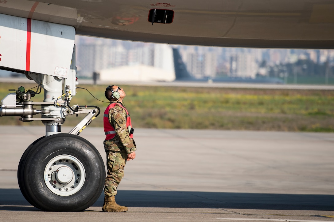 Staff Sgt. Jeff Jordan, 728th Air Mobility Squadron Maintenance Section crew chief checks the bottom of an aircraft prior to takeoff March 19, 2019, at Incirlik Air Base, Turkey. Unique to the 728th AMS, maintenance airmen are assigned to the unit to maintain transit aircraft when needed. (U.S. Air Force photo by Staff Sgt. Ceaira Tinsley)