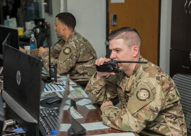 Senior Airman Paul Withrow, 728th Air Mobility Squadron information controller, radios for a flight update April 16, 2019, at Incirlik Air Base, Turkey. The air terminal operations center is responsible for all coordination between the terminal, Airmen in the freight and the aircraft itself to keep all sections updated and synchronized. (U.S. Air Force photo by Staff Sgt. Kirby Turbak)