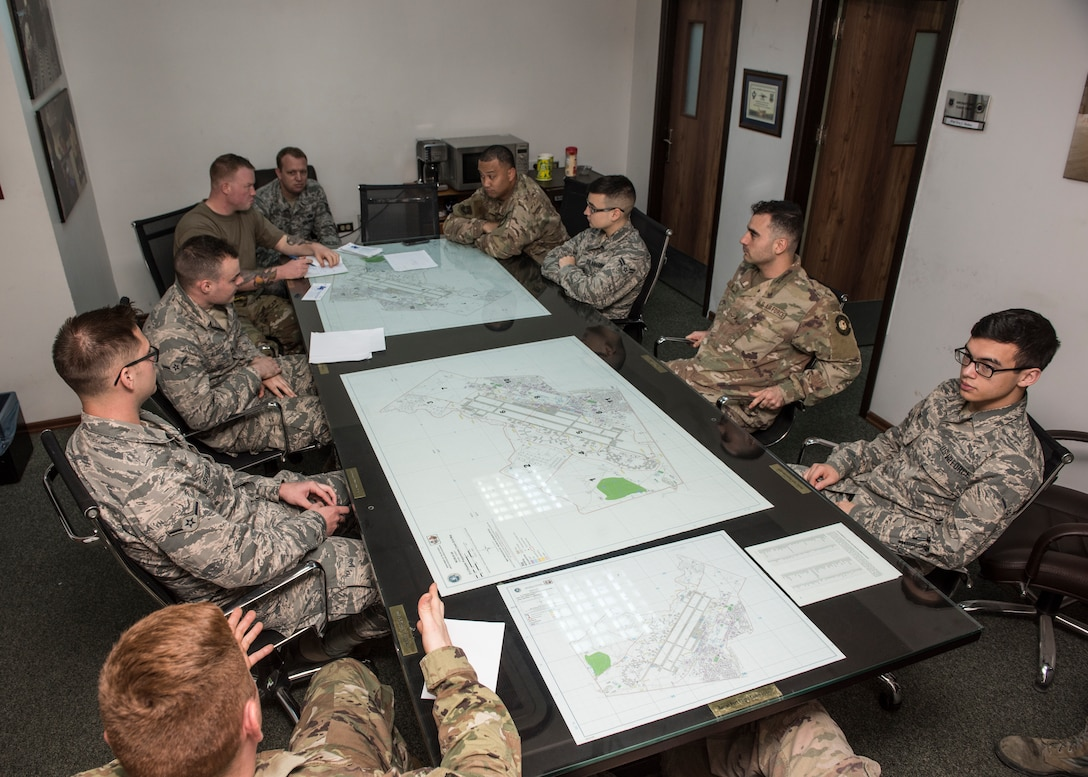 Airmen from the 728th Air Mobility Squadron conduct a meeting April 18, 2019, at Incirlik Air Base, Turkey. The unit provides expertise in three core competencies: aerial port operations, aircraft maintenance and command and control to support operations in Eastern Europe, Africa and Southwest Asia. (U.S. Air Force photo by Staff Sgt. Kirby Turbak)