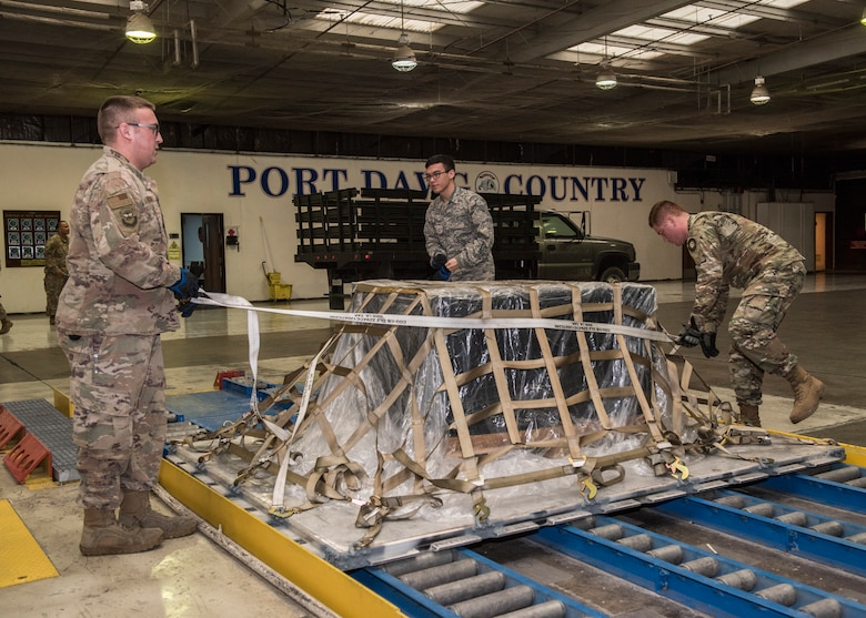 Airmen from the 728th Air Mobility Squadron secure a pallet April 16, 2019, at Incirlik Air Base, Turkey. The squadron falls under the 521st Air Mobility Operations Group, headquartered at Naval Station Rota, Spain and the 521st Air Mobility Operations Wing, headquartered at Ramstein Air Base, Germany. (U.S. Air Force photo by Staff Sgt. Kirby Turbak)