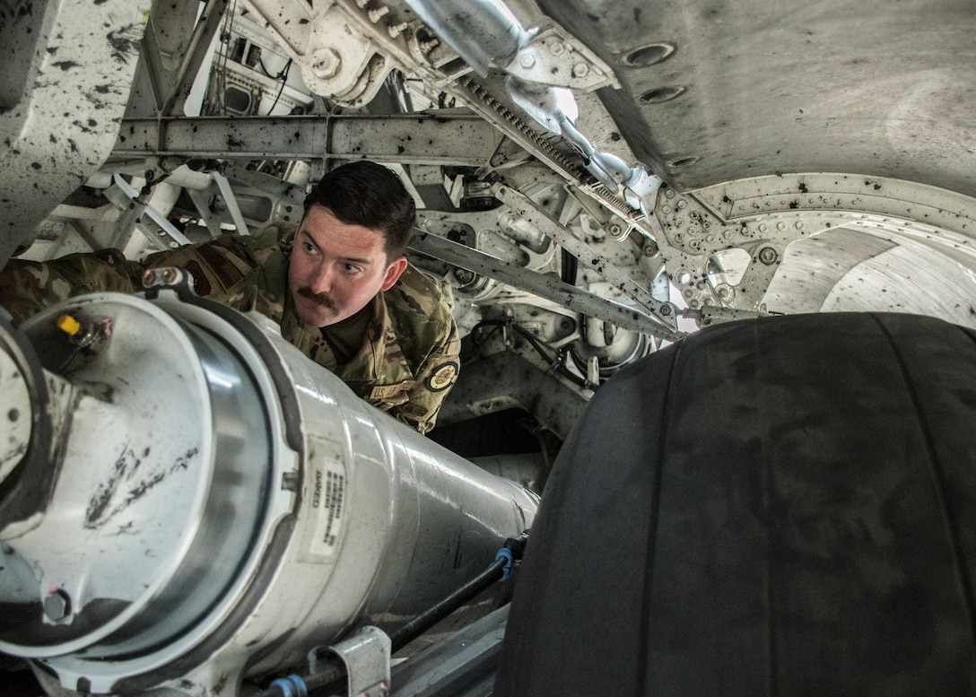 Staff Sgt. Alexander Trexler, 728th Air Mobility Squadron crew chief, conducts a preflight inspection April 18, 2019, at Incirlik Air Base, Turkey. Crew chiefs perform maintenance as well as help guide and direct aircraft on the flightline. (U.S. Air Force photo by Staff Sgt. Kirby Turbak)