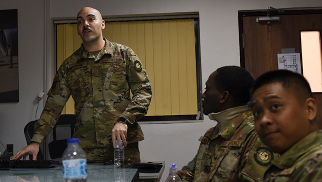 Staff Sgt. Matthew Bertini, 728th Air Mobility Squadron passenger services supervisor, briefs members on new Air Force regulations March 6, 2019, at Incirlik Air Base, Turkey. The 728th AMS leadership created a Solutions Group comprised of junior Airmen and NCOs designed to build confidence, solve problems and allow them to own their sections while making failures in a safe environment. (U.S. Air Force photo by Staff Sgt. Matthew J. Wisher)