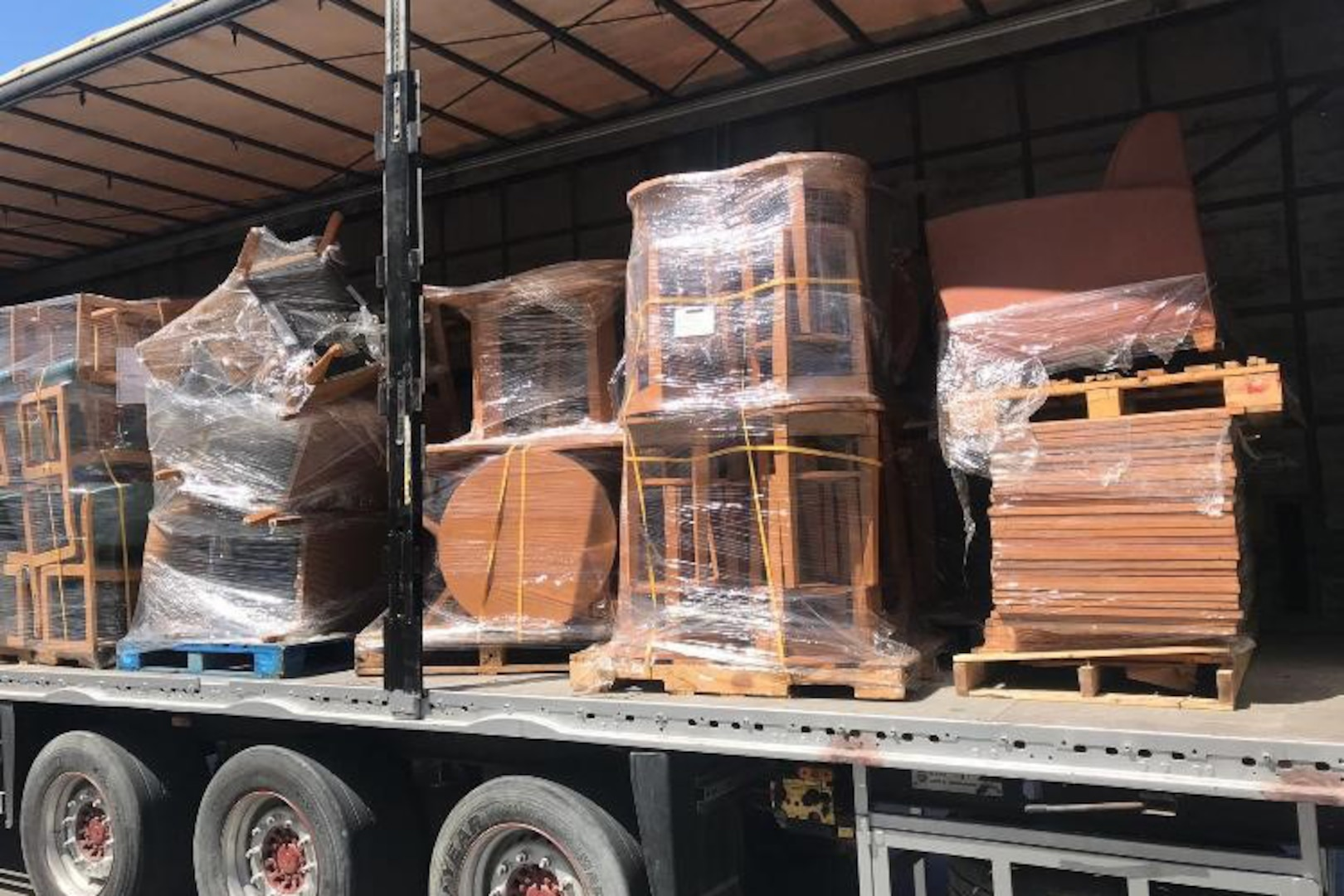More chairs and some tables await transport from the DLA Disposition Services site in Bahrain to the local Red Crescent Society where they will help those in need.