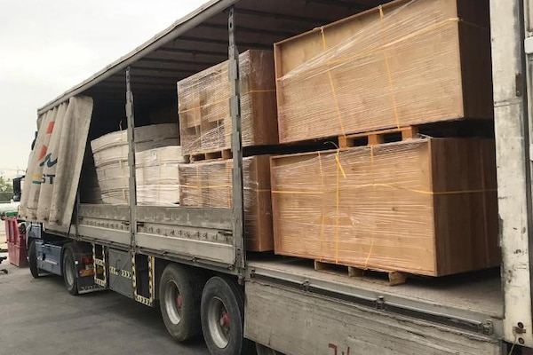 Mattresses and bed frames await transport from the DLA Disposition Services site in Bahrain to the local Red Crescent Society where they will help those in need.