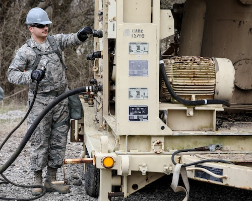 Staff Sgt. Jarrad Faulkner, 445th Civil Engineering Squadron, salvages parts of a reverse osmosis water purification unit during the annual Agile Combat Support exercise at the Warfighter Training Center April 7, 2019.