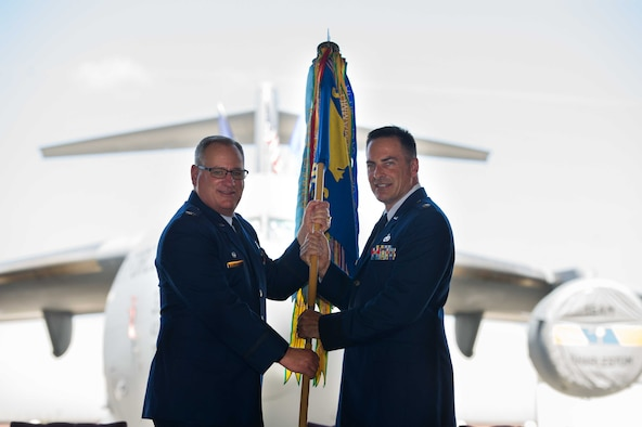 Lt. Col. Taylor Adams (right) receives the 315th Maintenance Squadron guidon from Col. Thomas Walter, 315th Maintenance Group commander, during a change-of-command ceremony Saturday, May 4, 2019, at Joint Base Charleston, S.C.