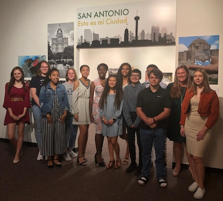 "Students from the Cole High School photography program and their teacher, Brenda Marafioto (second from right) attend the opening reception of the ""San Antonio: Esta es mi Ciudad"" exhibit at the Institute of Texan Cultures March 29. The exhibit displays 31 images taken from among 16 students in the Cole photography program."