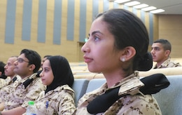 Officers in the Bahrain Defense Force listen to a speaker during a medical subject matter expert exchange at the Crown Prince Center of Training and Medical Research in Bahrain, April 14, 2019.