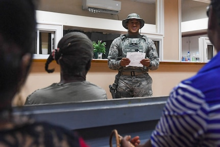 U.S. Air Force Staff Sgt. Charles Owens briefs Guyanese patients about ophthalmology surgery postoperative care during New Horizons exercise 2019 at Port Mourant, Guyana, May 4, 2019.