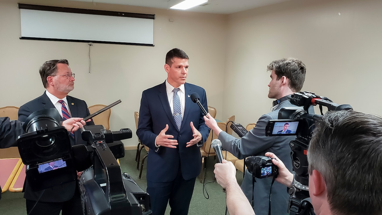 U.S. Sentator for Michigan, Gary Peters, left, introduces John W. Henderson, Assistant Secretary of the Air Force for Installations, Environment and Energy, to provide interviews for the media regarding the restoration efforts for PFOS/PFOA at the former Wurtsmith Air Force Base in Oscoda, Mich., April 24, 2019. (U.S. Air Force photo by Malcolm McClendon)