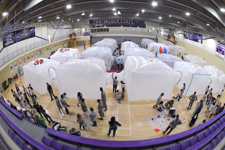 Fifth grade students inflate simulated space habitats during 'Mission to Mars' at Weber State University May 2, 2019. Mission to Mars is facilitated by Hill Air Force Base as part of the STEM Outreach Program, which partners with local school teachers by providing a curriculum, materials and events to teach STEM-related subjects in a creative and fun environment. (U.S. Air Force photo by Todd Cromar)