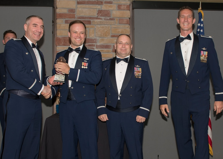Col. Joseph Campo, 49th Wing commander, presents Capt. Robert Ritchie, 8th FS F-16 Basic Course graduate, with an award, May 4, 2019, at Club Holloman on Holloman Air Force Base, N.M. Eight Viper pilot students graduated from the 8th FS first F-16 B-Course, nearly eighty years since the squadron's induction on Nov. 20, 1940. (U.S. Air Force photo by Airman 1st Class Kindra Stewart)