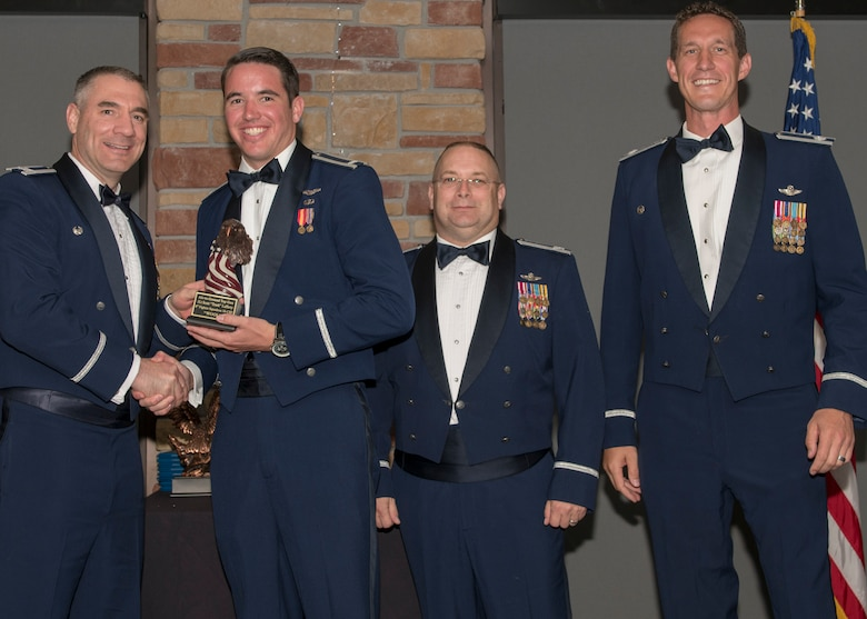 Col. Joseph Campo, 49th Wing commander, presents 1st Lt. Scott Lafferty, 8th FS F-16 Basic Course graduate, with an award, May 4, 2019, at Club Holloman on Holloman Air Force Base, N.M. Eight Viper pilot students graduated from the 8th FS first F-16 B-Course, nearly eighty years since the squadron's induction on Nov. 20, 1940. (U.S. Air Force photo by Airman 1st Class Kindra Stewart)