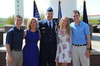 Brig. Gen. Ty Neuman (center), director of the Commander's Action Group for U.S. Strategic Command, is pictured with his family (from right to left), his son Trevor, his wife Shellie, his daughter Abbie and his son Jacob during his promotion ceremony to the rank of brigadier general at Offutt Air Force Base, May 3, 2019.