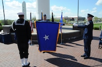 The Brigadier General flag is unfurled for Brig. Gen. Ty Neuman (center), director of the Commander's Action Group for U.S. Strategic Command, during his promotion ceremony at Offutt Air Force Base, May 3, 2019.